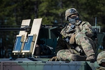 Airman 1st Class Devin Brown, 824th Base Defense Squadron fireteam member, sits on a Humvee during a Mission Readiness Exercise, March 13, 2018, at Joint Base McGuire-Dix Lakehurst, N.J. Evaluators tested the 824th BDS from Moody Air Force Base, Ga., and the 105th Security Forces Squadron from Stewart Air National Guard Base, N.Y., to ensure their combat readiness. (U.S. Air Force photo by Senior Airman Janiqua P. Robinson)
