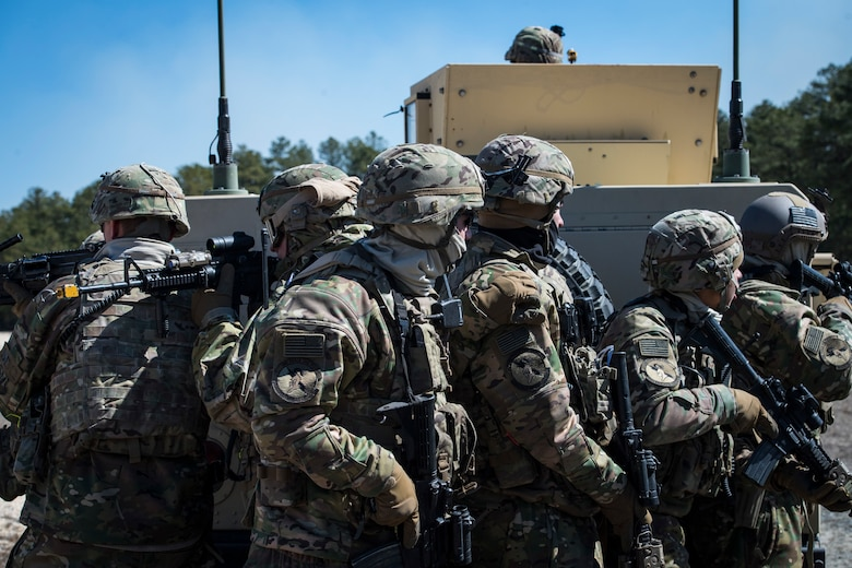 Airmen from the 824th Base Defense Group form up behind a Humvee during a Mission Readiness Exercise, March 13, 2018, at Joint Base McGuire-Dix Lakehurst, N.J. Evaluators tested the 824th BDS from Moody Air Force Base, Ga., and the 105th Security Forces Squadron from Stewart Air National Guard Base, N.Y., to ensure their combat readiness. (U.S. Air Force photo by Senior Airman Janiqua P. Robinson)