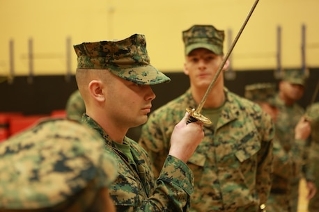 Sgt. Lonnie A. Cooley, instructor, Corporal's Course 630-18, U.S. Marine Corps Forces Command, demonstrates sword manual at Hopkins Hall Gym aboard Camp Allen, Norfolk, Va., March 21. The instructors demonstrated the proper technique for sword manual to the students in preparation for their test later that week. (Official U.S. Marine Corps photo by Sgt. Mark Tuggle/Released)