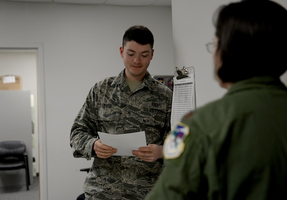 Airman 1st Class Jacob Davis, 14th Student Squadron aviation resource manager, helps a pilot with flying profile records March 20, 2018, on Columbus Air Force Base, Mississippi. Aviation Resource Management specialists maintain flight records to validate aircrew safety requirements, making sure every mission is ready to go according to plan. (U.S. Air Force photo by Airman 1st Class Keith Holcomb)