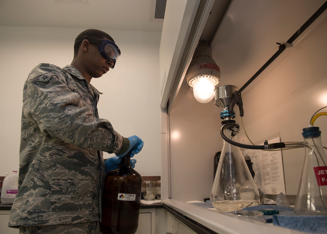 Senior Airman Matthew Boyles, a fuels laboratory technician assigned to the 97th Logistics Readiness Squadron, prepares to test a sample of aircraft fuel, Feb. 21, 2018, at Altus Air Force Base, Okla. Members of the fuels lab perform quality analysis on petroleum products by checking for a variety of possible issues like contamination and the conductivity of the fuel. (U.S. Air Force photo by Senior Airman Kirby Turbak)