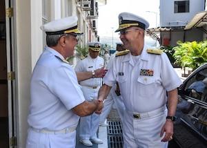 Vice Adm. Forrest Faison, Navy surgeon general and chief, U.S. Navy Bureau of Medicine and Surgery, bids farewell to Vice Adm. Edmar da Cruz Areas