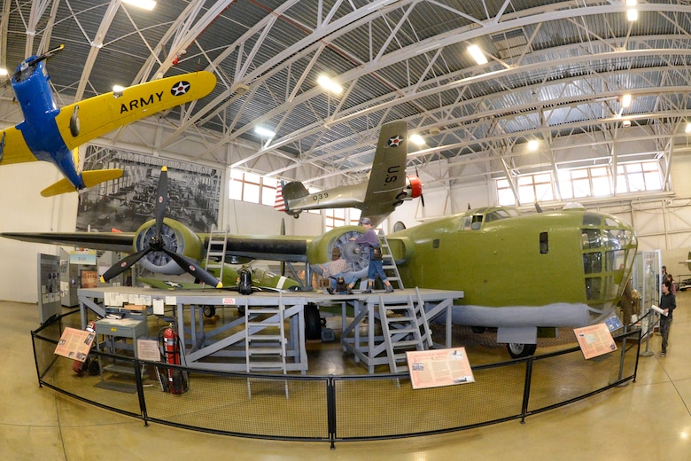 A B-24 bomber sits on display inside the Hill Aerospace Museum at Hill Air Force Base, Utah, March 13, 2018. The aircraft was in service during World War II, and crashed in the Aleutian Islands of Alaska. It was recovered and restored by the Aerospace Heritage Foundation of Utah. (U.S. Air Force photo by Todd Cromar)