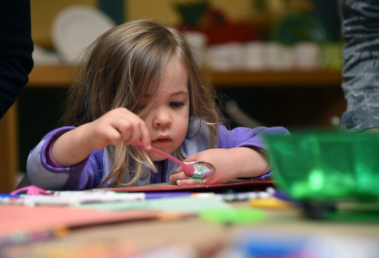 Charlotte Peterson, daughter of U.S. Air Force Lt. Col. Andrew Peterson, 81st Mission Support Group deputy commander, decorates a hand cut-out during an arts and crafts session at the McBride Commons March 21, 2018, on Keesler Air Force Base, Mississippi. Keesler children and their mothers attended the event which was held in recognition of Women's History Month. A luncheon will also be held to remember women's history March 27 at the Bay Breeze Event Center. (U.S. Air Force photo by Kemberly Groue)
