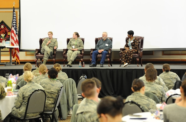 Maj. Samantha Miller, left, 341st Force Support Squadron commander, talks about working in a diverse environment during a women's symposium panel discussion March 20, 2018, at Malmstrom Air Force Base, Mont. The two-day event included numerous guest speakers who discussed topics ranging from diversity and mentorship to money management and balancing military life with personal life. (U.S. Air Force photo by Christy Mason)