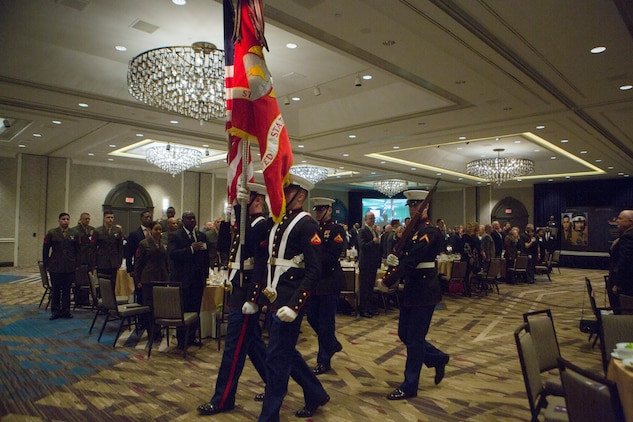 A color guard exits the auditorium after the playing of To The Colors during the opening ceremony of the Marine Corps Association and Foundation's 14th annual Ground Logistics Awards Dinner at the Crystal Gateway Marriott, Arlington, Virginia, March 22, 2018. The dinner provides the formal opportunity to recognize the professional achievements of the top performing Marine logisticians and logistics unit of the year for the previous year. (U.S. Marine Corps photo by Cpl. Dallas Johnson)