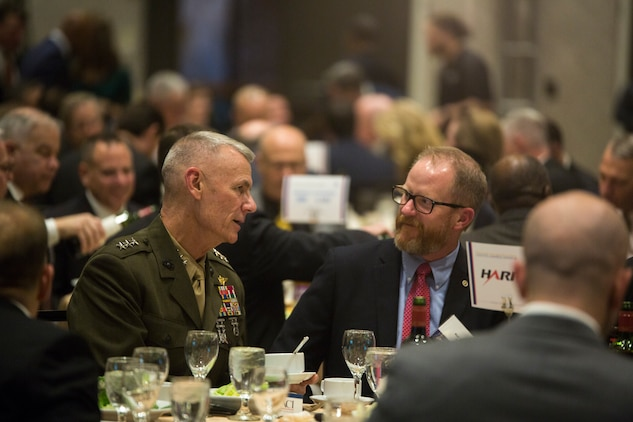 Lt. Gen. Rex C. McMillian, commander of Marine Forces Reserve and Marine Forces North, talks with an attendee at the Marine Corps Association and Foundation's 14th annual Ground Logistics Awards Dinner at the Crystal Gateway Marriott, Arlington, Virginia, March 22, 2018. Competing against every logistics unit in the Marine Corps, Reserve unit Marines Wing Support Squadron 473 has, for the first time in the awards history, won the Marine Corps Logistics Organization/Team of the Year for a large unit award for all their humanitarian and relief efforts with hurricane's Harvey and Irma, as well as aide relief for a plane crash in Mississippi. (U.S. Marine Corps photo by Cpl. Dallas Johnson)