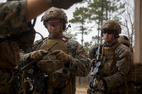 Cpl. Samuel Valderas primes an exterior strip charge during an urban breaching range at Camp Lejeune, N.C., Feb. 12, 2018. The range was conducted in preparation for the platoon's upcoming deployment with the 22nd Marine Expeditionary Unit. Valderas is a reconnaissance Marine with 2nd Reconnaissance Battalion, 2nd Marine Division. (U.S. Marine Corps photo by Cpl. Victoria Ross)