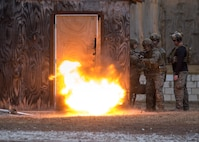 Marines with 2nd Reconnaissance Battalion, 2nd Marine Division use an exterior strip charge to gain entry through a doorway during an urban breaching range at Camp Lejeune, N.C., Feb. 12, 2018. The range was conducted in preparation for the platoon's upcoming deployment with the 22nd Marine Expeditionary Unit. The range allowed Marines to get hands-on training before moving on to qualifying exercises for the MEU. (U.S. Marine Corps photo by Cpl. Victoria Ross)