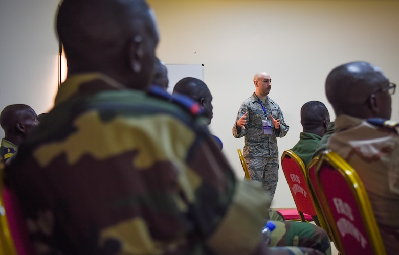 Chief Master Sgt. Ken Hauck, 48th Fighter Wing staff agencies superintendent, answers questions during an air and ground safety group discussion during African Partnership Flight Senegal at Captain Andalla Cissé Air Base, Senegal, March 20, 2018. APF Senegal involves approximately 40 U.S. Airmen from U.S. Air Forces in Europe and Air Forces Africa, the West Virginia Air National Guard, the 818th Mobility Support Advisory Squadron, and the Language Enabled Airman Program. (U.S. Air Force photo by Capt. Kay Magdalena Nissen)