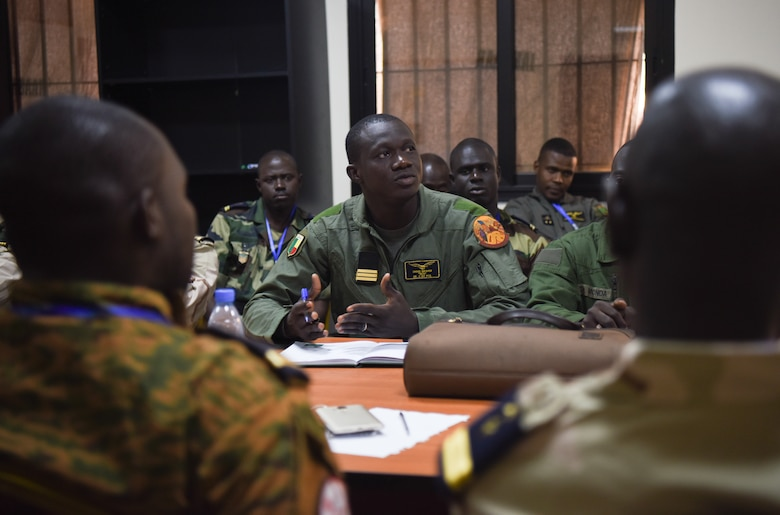 Benin helicopter pilot, Capt. Chabi Ibrahim, discusses safety in air operations during African Partnership Flight Senegal at Captain Andalla Cissé Air Base, Senegal, March 20, 2018. APF Senegal is a multilateral, military-to-military engagement emphasizing security assistance with African air forces. (U.S. Air Force photo by Capt. Kay Magdalena Nissen)