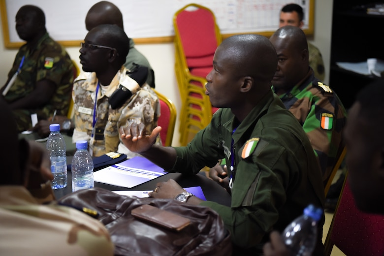 Ivoirian Maj. Katienna Ouattara, asks a question at group discussions for air and ground safety during African Partnership Flight Senegal at Captain Andalla Cissé Air Base, Senegal, March 20, 2018. APF Senegal supports U.S. Africa Command's priority to build capacity for humanitarian assistance and disaster response with African partners. (U.S. Air Force photo by Capt. Kay Magdalena Nissen)