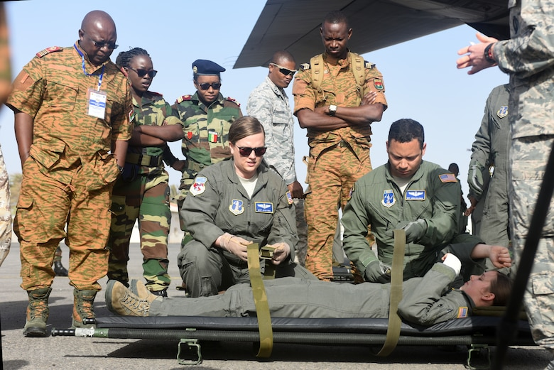 West Virginia Air National Guard medical technicians, assigned to the 167th Aeromedical Evacuation Squadron, demonstrate how to load a patient onto a litter at Captain Andalla Cissé Air Base, Senegal, March 22, 2018. The demonstration was part of African Partnership Flight Senegal, an event co-hosted by the U.S. and Senegal that focuses on the exchange of knowledge in the aeromedical and casualty evacuation fields, as well as air and ground safety. (U.S. Air Force photo by Airman 1st Class Eli Chevalier)
