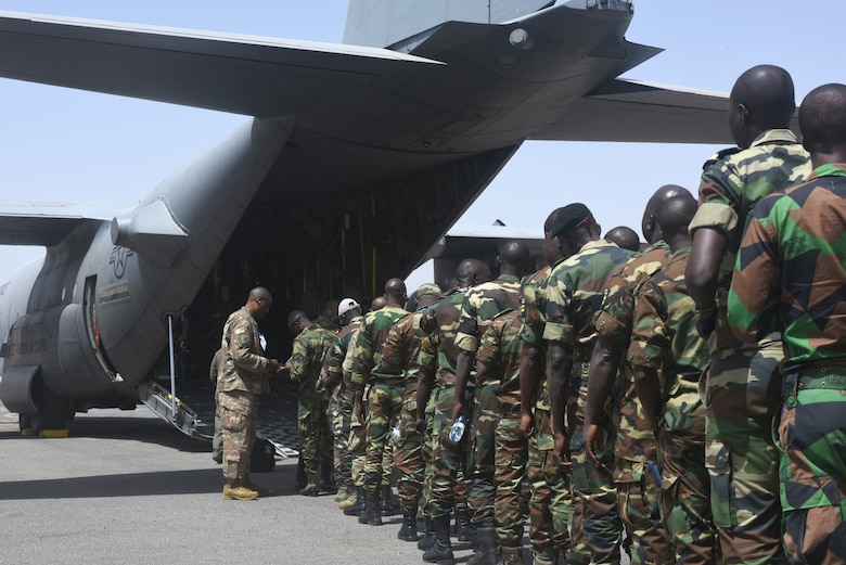 Participants of African Partnership Flight Senegal prepare to board a C-130H Hercules, assigned to the 130th Airlift Wing, West Viginia Air National Guard, at Captain Andalla Cissé Air Base, Senegal, March 22, 2018. The APF program is U.S. Air Forces Africa's premier security cooperation program with African partner nations to improve professional military aviation knowledge and skills. (U.S. Air Force photo by Airman 1st Class Eli Chevalier)