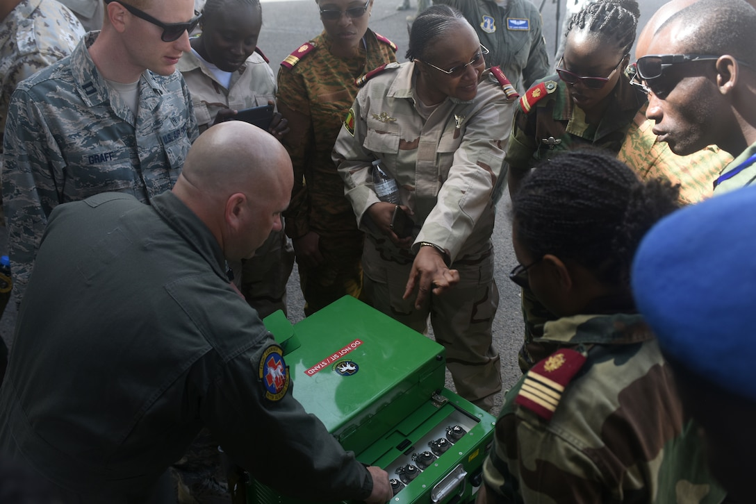 Chief Master Sgt. Matt Lyons, 167th Aeromedical Evacuation Squadron medical technician, explains the liquid oxygen system used onboard C-130H Hercules aircraft at Captain Andalla Cissé Air Base, Senegal, March 22, 2018. The 186th AES is in Dakar in support of African Partnership Flight Senegal, a military-to-military event co-hosted by Senegal and the U.S. focusing on casualty evacuation, aeromedical evacuation and air and ground safety. (U.S. Air Force photo by Airman 1st Class Eli Chevalier)