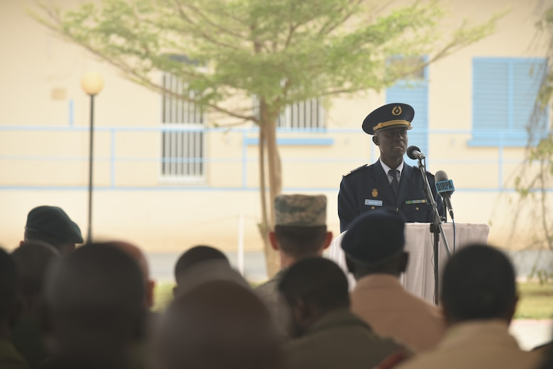 Senegalese Col. Boucar Sene, second in command of the Senegalese air force, speaks during the closing ceremony of African Partnership Flight Senegal at  Captain Andalla Cissé Air Base, Senegal, March 23, 2018 The APF program is U.S. Air Forces in Africa's premier security cooperation program with African partner nations to improve professional military aviation knowledge and skills. (U.S. Air Force photo by Airman 1st Class Eli Chevalier)