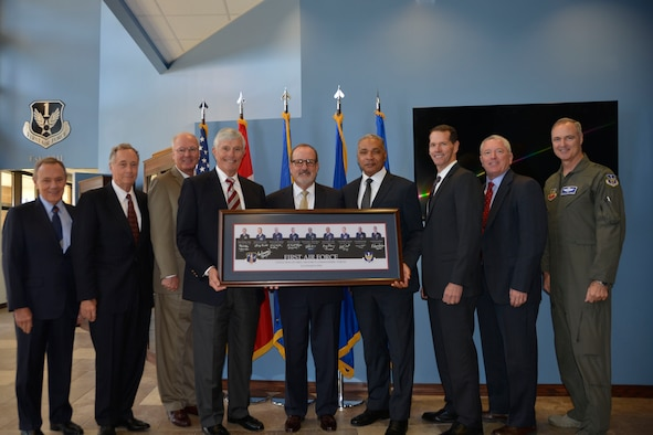"In order of succession, eight former 1st Air Force commanders stand with the current 1st Air Force commander, Lt. Gen. R. Scott Williams, with a commemorative picture of themselves at the Killey Center for Homeland Operations March 13. The leaders were here for the ""Evolution of 1st Air Force Commander's Forum,"" held March 13-14, which brought together previous, from 1994 to the present,  for a discussion on how their previous command experience lessons could enhance the success of both present and future enterprise operations.  (Air Force Photo by Mary McHale)"