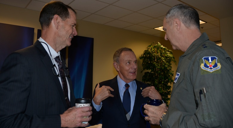 "Maj. Gen. (Ret.) Philip Killey, former 1st AF commander, talks with Lt. Gen. R. Scott Williams, 1st Air Force Commander, and Lt. Gen. (Ret.) Sid Clarke III (left) March 13, during the ""Evolution of 1st Air Force Commander's Forum."" The event, held March 13-14, brought together eight previous 1st Air Force commanders, from 1994 to the present, for a discussion on how their previous command experience lessons could enhance the success of both current and future enterprise operations.  (Air Force Photo by Mary McHale)"