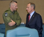 "BGen Sylvain Menard, Continental U.S. NORAD Region Deputy Commander, talks with Maj. Gen. (Ret.) Philip Killey, during the ""Evolution of 1st Air Force Commander's Forum"" March 14. The event, held March 13-14, brought together eight previous 1st Air Force commanders, from 1994 to the present, for a discussion on how their previous command experience lessons could enhance the success of both current and future enterprise operations.  (Air Force Photo by Mary McHale)"