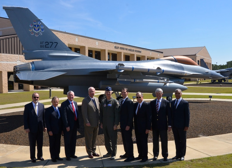 "Eight former 1st Air Force commanders flank the current  1st AF Commander, Lt. Gen. R. Scott Williams, for a photo opportunity with the 1st Air Force F-16 Fighting Falcon March 13. The leaders were here for the ""Evolution of 1st Air Force Commander's Forum,"" held March 13-14, which brought together eight previous 1st Air Force commanders, from 1994 to the present, for a discussion on how their previous command experience lessons could enhance the success of both current and future enterprise operations.  (Air Force Photo by Mary McHale)"