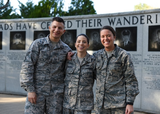 U.S. Air Force Airman 1st Class Emmett Berry, 96th Security Forces Squadron member, left, Airman 1st Class Elizabeth Berry, 33rd Fighter Wing supply support journeyman, center, Airman 1st Class Toula Goumas, 96th aerospace medical technician, right, pose for a photo March 21, 2018, at Eglin Air Force Base, Fla. These Airmen shared their journey into the Air Force and how all three were stationed at Eglin Air Force Base, Fla. (U.S. Air Force Airman 1st Class Daniella Pena)