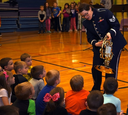 Staff Sgt. Helena Giammarco, USAF Band of Mid-America's Mobility Brass Quintet member, explains the mechanics of her French Horn instrument during a performance at Mascoutah Elementary School, Illinois March 14, 2018. The performance were part of Air Mobility Command's contribution to the Music in Our Schools month initiative. Giammarco hails from Besançon, France, and was previously a U.S. Navy Band member. (U.S. Air Force photo by Candy Knight)