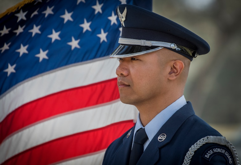 Senior Airman Jarrish Toledo, 96th Inpatient Operations Squadron, stands at parade rest prior to the honor guard graduation ceremony March 1, 2018, at Eglin Air Force Base, Fla. Approximately 13 new Airmen graduated from the 120-plus-hour course. The graduation performance includes flag detail, rifle volley, pall bearers and bugler for friends, family and unit commanders. (U.S. Air Force photo by Samuel King Jr.)