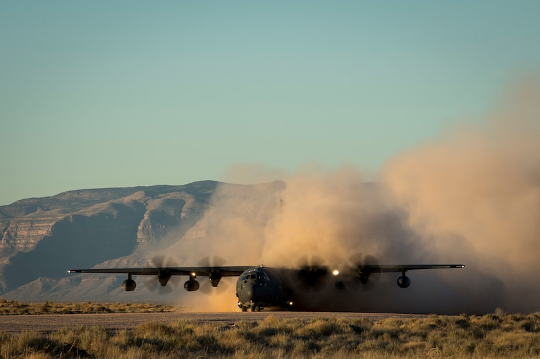 An MC-130J Commando II, assigned to the 9th Special Operations Squadron, lands at Orogrande, N.M., in preparation for the Marine Corps' high-mobility artillery rocket system launch during Exercise Emerald Warrior 18, March 5, 2018. The 14th Marine Regiment, is one of two Marine Corps HIMARS field artillery battalions, that provide fire support in austere locations.  (U.S. Air Force photo by Tech. Sgt. Larry E. Reid Jr.)