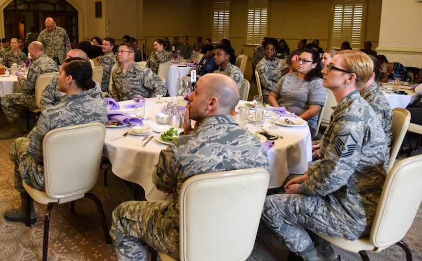Guests attending a Women's History Month luncheon held in the Charleston Club listen to a speech March 20, 2018, at Joint Base Charleston, S.C.