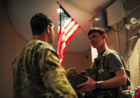 A U.S. Air Force pararescueman from the 48th Rescue Squadron out of Davis-Monthan Air Force Base, Ariz., talks to a Buena High School student in Sierra Vista, Ariz., about the importance of the pararescuemen's mission Feb. 23, 2018. The pararescueman also told the student about different agencies within the Air Force that help support the protection of the U.S. and our allies. (U.S. Air Force photo by Airman 1st Class Frankie D. Moore)
