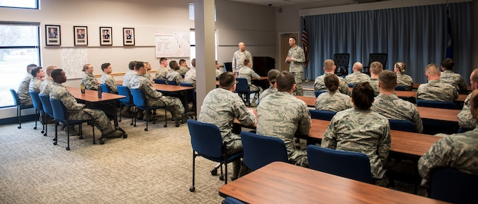 Lt. Gen. GI Tuck, 18th Air Force commander, and Chief Master Sgt. Todd Petzel, 18th AF command chief, speak with Airman Leadership School students during a base tour March 21, 2018, at Fairchild Air Force Base, Washington. Tuck and Petzel visited Airmen in their work environments to discuss their goals, priorities and expectations for everyone on the 18th AF team. (U.S. Air Force photo/Senior Airman Sean Campbell)