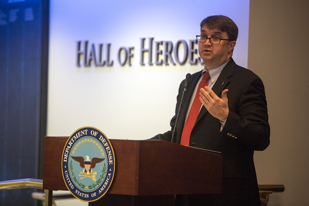 Honorable Robert Wilkie, Under Secretary of Defense for Personnel and Readiness, speaks to a gathering of service members from each military branch about the importance of family readiness at the 2017 Department of Defense Family Readiness Award, at the Pentagon's Hall of Heroes, Arlington, Virginia, March 23, 2018. The ceremony was held to recognize Combat Logistics Battalion 451,4th Marine Logistics Group, and top units from each branch, for having outstanding support programs for service members and their families. (U.S. Marine Corps photo by Cpl. Dallas Johnson)