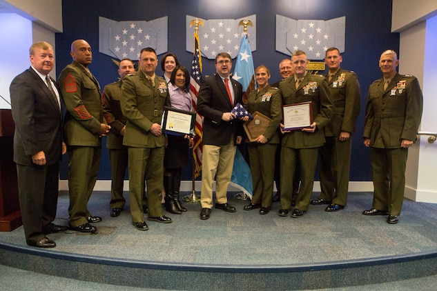 Lt. Gen. Rex C. McMillian (right), commander of Marine Forces Reserve and Marine Forces North, poses with Marines with Combat Logistics Battalion 451, 4th Marine Logistics Group, Marine Forces Reserve, after they receive the 2017 Department of Defense Family Readiness Award, at the Pentagon's Hall of Heroes, Arlington, Virginia, March 23, 2018. Established in 2000, the DoD Reserve Family Readiness Award recognizes the top unit in each of the seven Reserve components, which are a vital link in the support networks for Reserve component families. (U.S. Marine Corps photo by Cpl. Dallas Johnson)