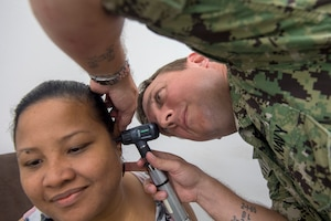 Lt. Matt Thomas, an audiologist supporting Pacific Partnership 2018 (PP18), examines a patient's ear during a community health fair at the Yap Memorial Hospital, March 23. PP18's mission is to work collectively with host and partner nations to enhance regional interoperability and disaster response capabilities, increase stability and security in the region, and foster new and enduring friendships across the Indo-Pacific Region. Pacific Partnership, now in its 13th iteration, is the largest annual multinational humanitarian assistance and disaster relief preparedness mission conducted in the Indo-Pacific.