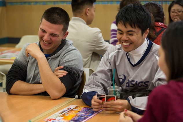 local and military community gather to play cards and learn English at the AEON MALL