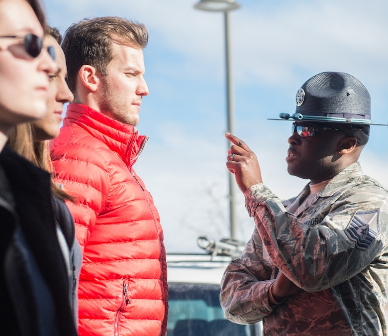 U.S. Air Force Master Sgt. Alonso Blackman, 673d Medical Support Squadron transfusion services section chief and a former basic training military training instructor, gives future Airmen a taste of basic military training in Anchorage, Alaska, March 13, 2018. Blackman taught the recruits the basics of drill, military bearing, dress and appearance, and reporting statements.