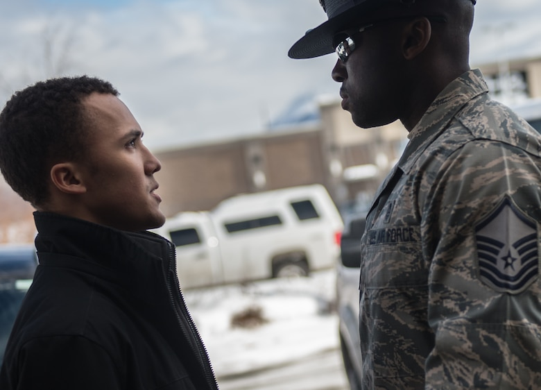U.S. Air Force Master Sgt. Alonso Blackman, 673d Medical Support Squadron transfusion services section chief and a former basic training military training instructor, gives a future Airman a taste of basic military training in Anchorage, Alaska, March 13, 2018. Blackman taught the recruits the basics of drill, military bearing, dress and appearance, and reporting statements.