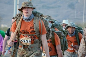 ROTC cadets walk together during the Bataan Memorial Death March. .