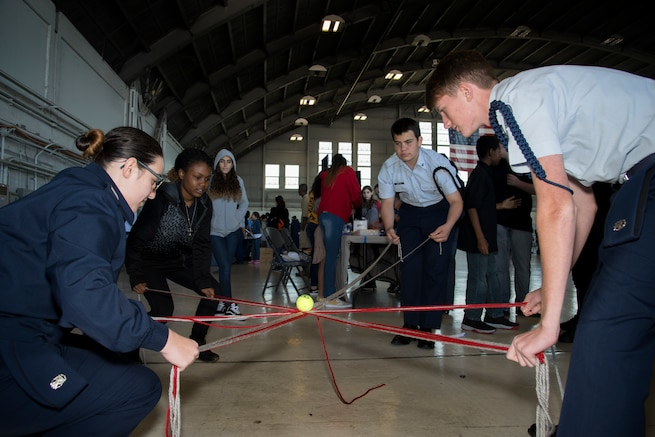 Florida Junior Reserve Officer Training Corps (JROTC) cadets participate in a team building exercise during the Science, Technology, Engineering, Arts and Math (STEAM) Day at MacDill Air Force Base, Fla., March 21, 2018.
