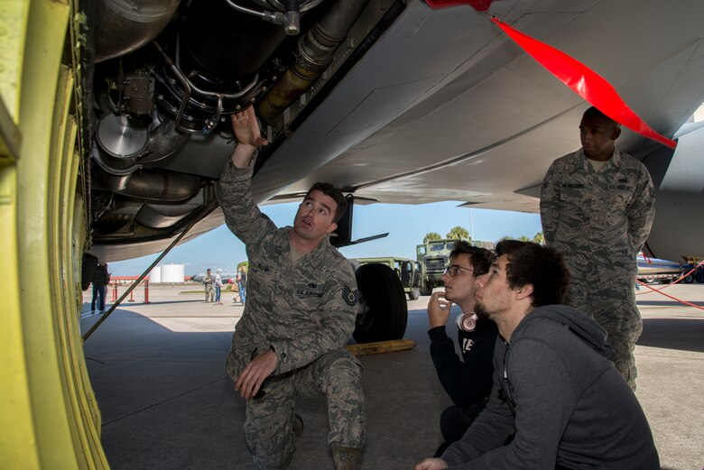U.S. Air Force Tech. Sgt. Jonathan Klenk, an electrical and environmental technician assigned to 6th Aircraft Maintenance Squadron, shows the air condition system of a KC-135 Stratotanker aircraft during the Science, Technology, Engineering, Arts and Math (STEAM) Day at MacDill Air Force Base, Fla., March 21, 2018.