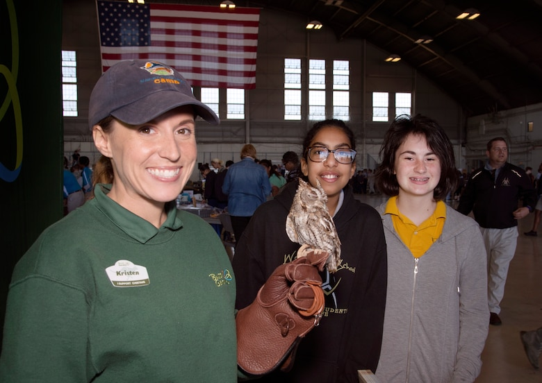 Kristen Gefre, a Busch Gardens education instructor, pauses for a photo with students during the Science, Technology, Engineering, Arts and Math (STEAM) Day at MacDill Air Force Base, Fla., March 21, 2018.