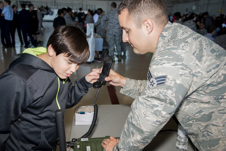 U.S. Air Force Senior Airman David Hamilton, a radio frequency transmission technician assigned to 6th Communication Squadron, demonstrates the use of a land mobile radio system during the Science, Technology, Engineering, Arts and Math (STEAM) Day at MacDill Air Force Base, Fla., March 21, 2018.