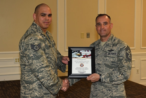 U.S. Air Force Staff Sgt. Christian Arvelo, Air Force Sergeants Association President Chapter 377 president, left, presents Chief Master Sgt. Daniel Hoglund, 20th Fighter Wing command chief, with an honorary president's award at Shaw Air Force Base, S.C., March 20, 2018.