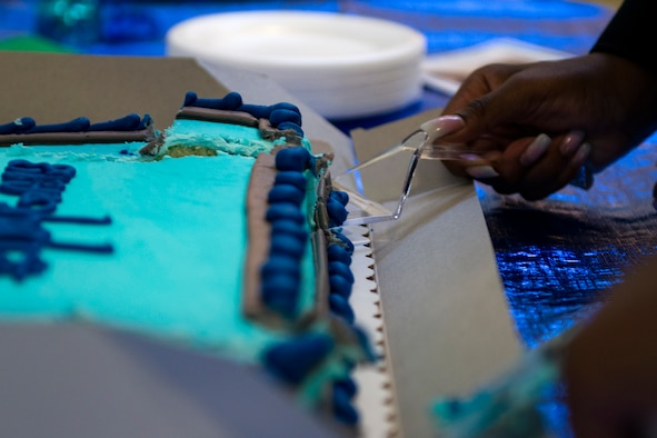 Nevaeh Wallace, daughter of Master Sgt. Marvin Wallace, 723d Aircraft Maintenance Squadron first sergeant, and Master Sgt. Yolanda Wallace, 23d Wing chapel assistant, cuts a cake during the Youth of the Year Finalist Celebration, March 23, 2018, at Moody Air Force Base, Ga. The Youth Center hosted the event to give parents and community members a chance to see the competitors give their speeches they presented during the Georgia State Youth of the Year Competition. This was the first time two competitors from southeast region made it to the semifinals at the same time. (U.S. Air Force photo by Airman 1st Class Erick Requadt)