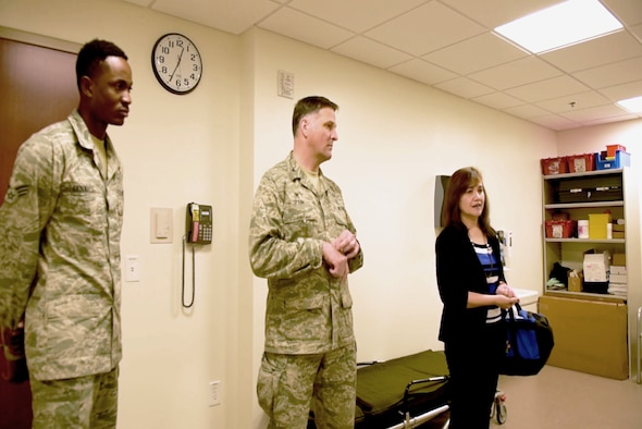 PETERSON AIR FORCE BASE, Colo. - Maria Bueno, 21st Medical Group patient safety program coordinator, Col. Scot Spann Commander, 21st MDG and Senior Airman Folarin Akinwale, 21st MDG uniform business office manager listen to the exercise rules for the Room of Horrors safety test, March 15, 2018. The test is designed to raise safety awareness and help Airmen recognize hazards quickly. (U.S. Air Force photo by Cameron Hunt)