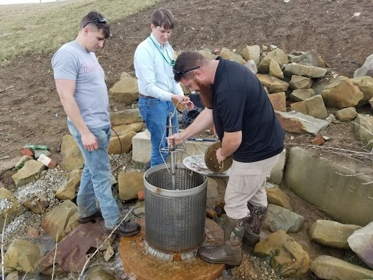 Measuring flow in a relief well as part of the Portsmouth-New Boston, Ohio local protection project during a recent high water event.