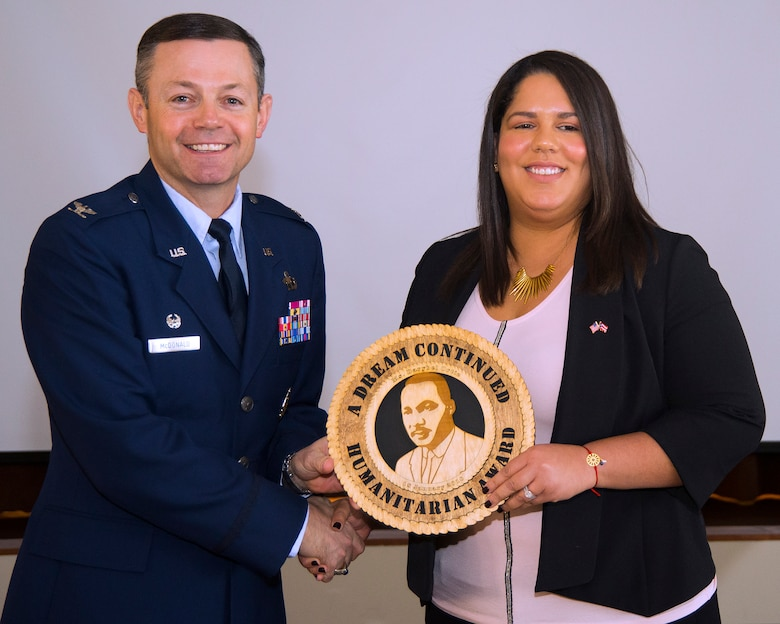 Col. Bradley McDonald, 88th Air Base Wing commander, awards Darybel Ortiz, National Air and Space Intelligence Center civilian, with the Martin Luther King Jr. Humanitarian Award during a luncheon at Wright-Patterson Air Force Base.