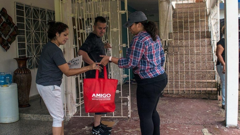 Darybel Ortiz delivers supplies to a family in Puerto Rico.