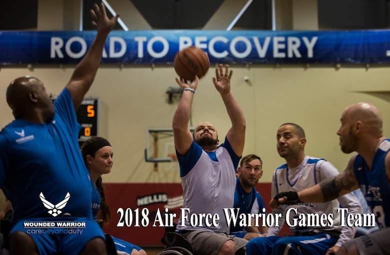 A competitor shoots while surrounded by defenders during the wheelchair basketball event in the 5th Annual Air Force Wounded Warrior Trials at the Warrior Fitness Center on Nellis Air Force Base, Nevada, Feb. 28, 2018.