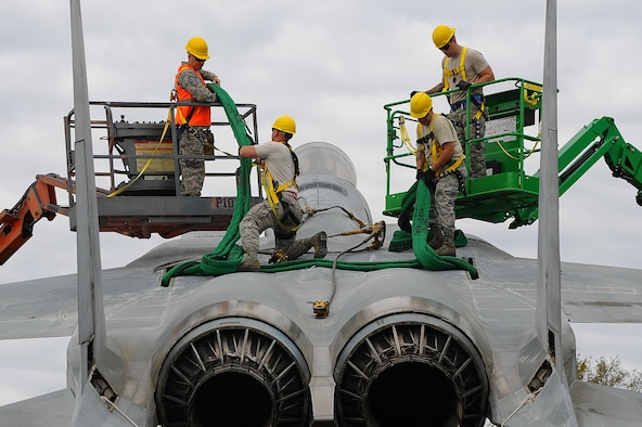 The 402nd Aircraft Maintenance Group removes the F-15 display and transports to the paint shop.